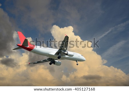 The plane was landing on dramatic sky-clouds background.