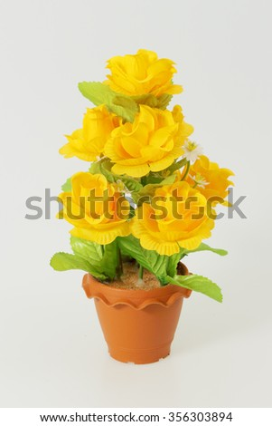 The Plastic flower in the pots on white background
