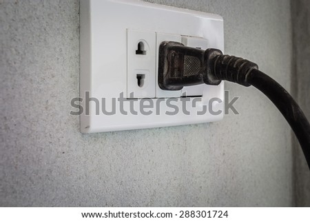 The plug is plugged into the power lines to bring electricity to the engine. Or other electrical equipment - stock photo