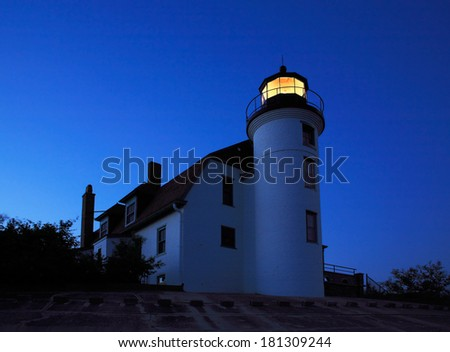 The Point Betsie Lighthouse Holds Vigil On The Lake Michigan Shoreline As Night Meets Day Just Before Sunrise, Michigan, Lower Peninsula, USA - stock photo