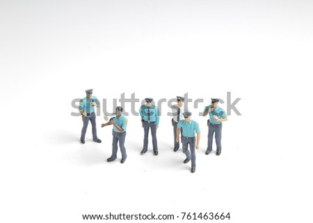 the Police officer stands in with stand