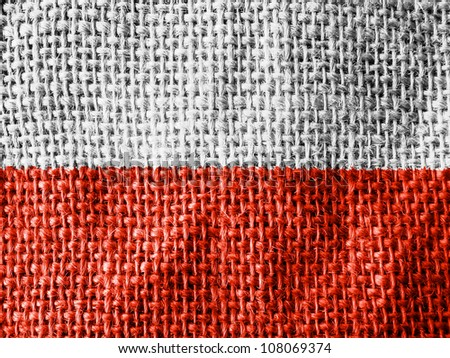 The Polish flag painted on fabric surface - stock photo