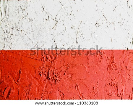 The Polish flag painted on wall - stock photo