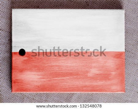 The Polish flag painted over wooden board - stock photo