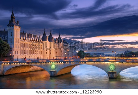 The Pont au Change, bridge over river Seine and the Conciergerie, a former royal palace and prison in Paris, France. - stock photo
