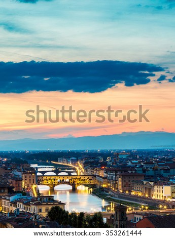 The Ponte Vecchio at sunset in Florence, Italy - stock photo