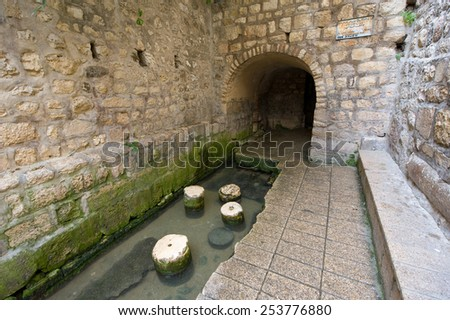The pool of Siloam at the end of Hezekiah's tunnel is a rock-cut pool on the southern slope of 'the City David' in Jerusalem - stock photo