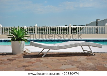 The Poolside outdoors; a photo of poolside outdoors under blue sky with clouds