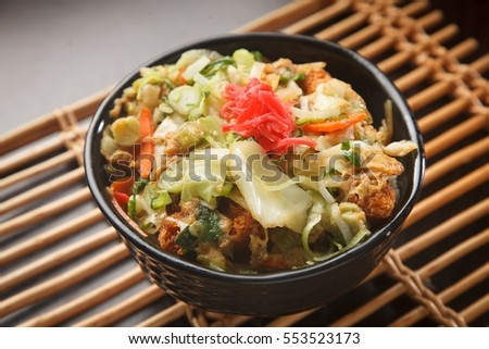 The popular Japanese food (Katsudon ) that ingredient are Fried Pork with egg, onion ,seaweed ,and rice where serve in resturant