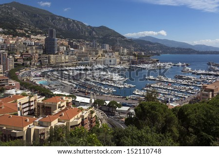 The Port of Monaco in the Principality of Monaco, a sovereign city state, located on the Cote d'Azur on the French Riviera. - stock photo