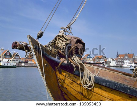 The port of Volendam,Holland.At foreground the  bow of an old wooden fisherboat.This village is a landmark in the Netherlands
