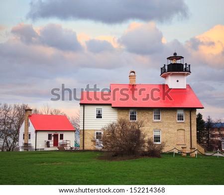 The Port Washington Lighthouse On A Cold Rainy Day In Early Spring, Port Washington Wisconsin, USA - stock photo