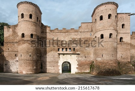 The Porta Asinaria is a gate in the Aurelian Walls of Rome. It was originally a simple gate,but Honorius added two semi-cylindrical towers to increase its resistance to the probable attacks of enemies - stock photo