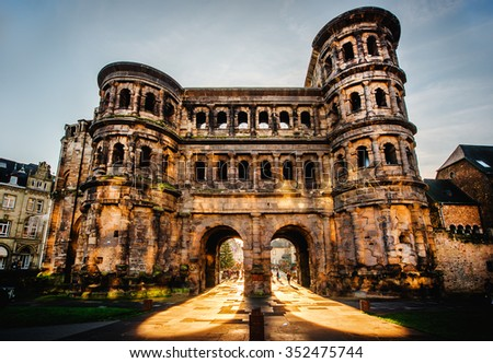 The Porta Nigra (Black Gate) in Trier city, Germany. It is a famous large Roman city gate. Front view. UNESCO World Heritage Site - stock photo