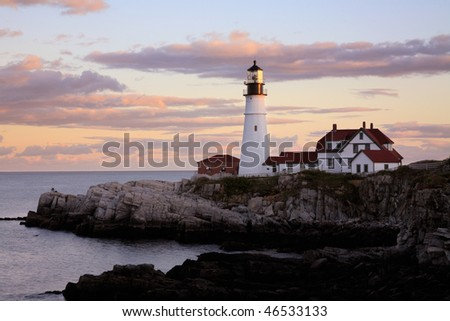 The Portland Head Light Readies Itself for duty As The Sun Retreats Over The Westward Horizon, Portland Maine - stock photo