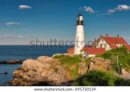 The Portland Head Lighthouse at sunset in Cape Elizabeth, Maine, USA.