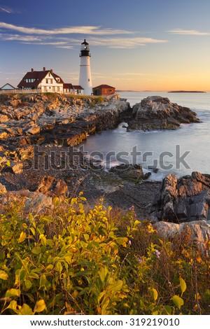 The Portland Head Lighthouse in Cape Elizabeth, Maine, USA. Photographed at sunrise. - stock photo