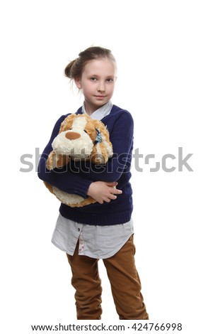 the portrait of a beautiful  little teenage girl hugs a  toy  isolated on white - stock photo