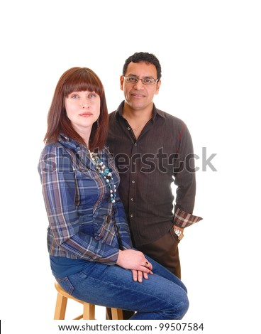 The portrait of a couple, Hispanic and Caucasian in there forties. She with red hair and he in brown clothing, for white background. - stock photo