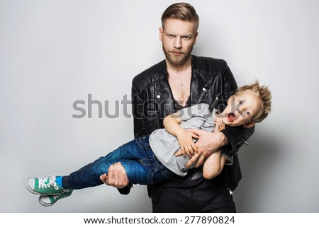 The portrait of a little boy and his father. Fathers day. Studio portrait over white background  - stock photo