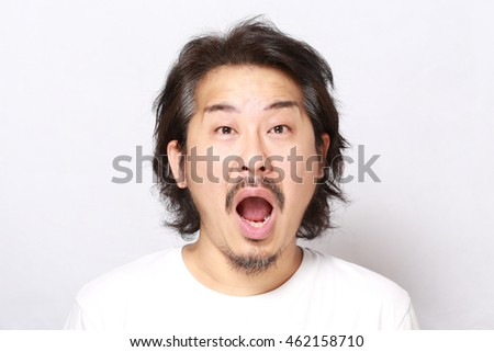 The portrait of Asian man on the white background.
