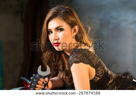 the portrait of Asian young beautiful woman in the leather jacket in warm tone