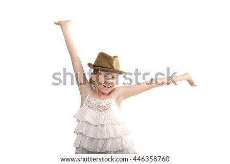 the portrait of funny happy little  teenage girl gesturing hands up on white background wearing on white dress and  light brown hat.  - stock photo