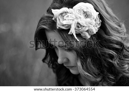 The portrait of sad,upset,unhappy beautiful,attractive,cute,pretty,nice girl with wreath,flowers.Black and white photo.Beautiful girl think about problems,worry about her boyfriend,broken heart,lovely - stock photo