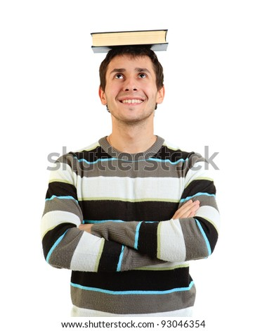 the portrait of student with book on the head against a white background - stock photo