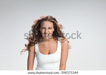 The portrait of violent and militant woman - stock photo