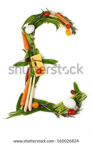 The pound sign made of vegetables with cheese in a middle. - stock photo