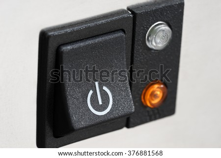 The power button, close-up - stock photo