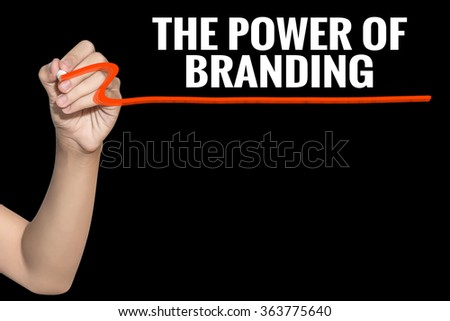 The Power of Branding word write on black background by woman hand holding highlighter pen - stock photo