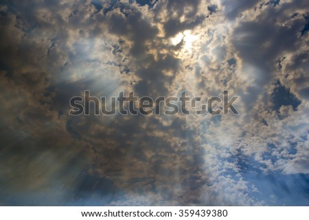 The powerful sun penetrating clouds and radiating through a smoke filled sky during a huge bushfire in South Western Australia. - stock photo