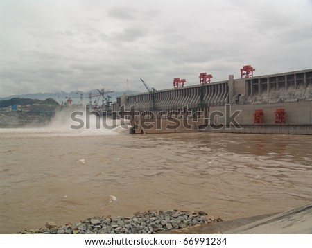 The powerful Three Gorges Dam on the Yangtze River in China - stock photo