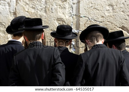 The prayer near Western Wall in Jerusalem - stock photo