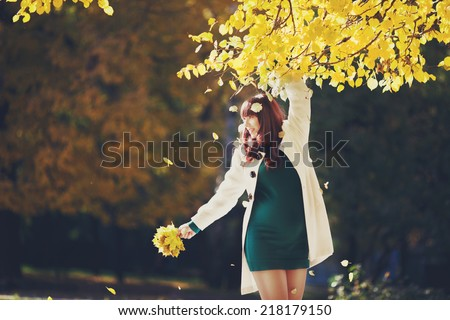 The pregnant woman on the background of nature. Autumn warm weather. Pregnant woman walk in the fresh air, sunny day. Waiting for the baby. health, beauty, autumn - the concept of lifestyle. - stock photo