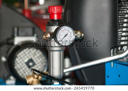 The pressure gauge on the air compressor  - stock photo