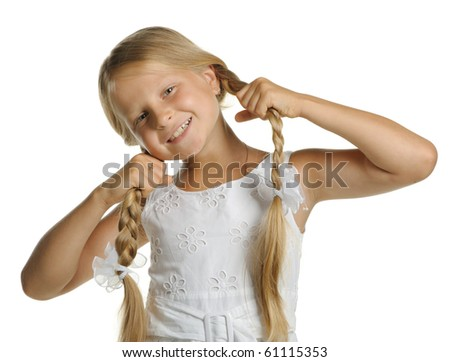The pretty blonde girl holding her braids isolated on a white background - stock photo