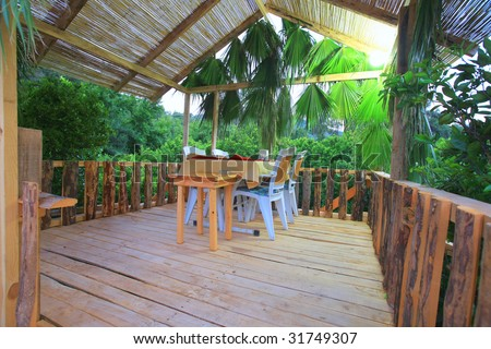 the pretty outside restaurant exterior with nature green atmosphere