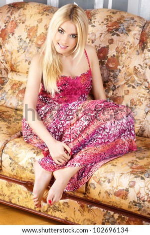 The pretty woman has relaxed on a sofa. - stock photo