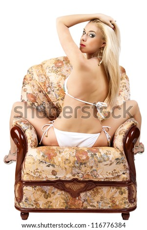 The pretty woman has relaxed on a sofa. White background. - stock photo