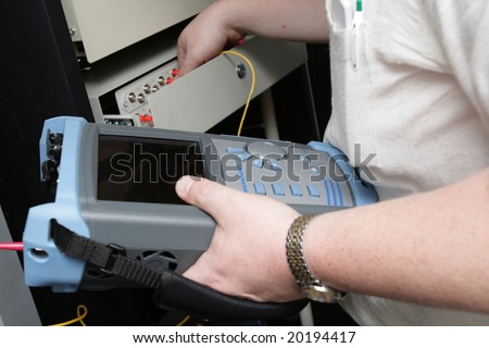 The preventive maintenance of fiber-optic link in site - stock photo
