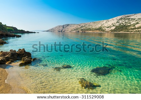 The pristine coastline and crystal clear water of the island of Rab, Croatia. - stock photo