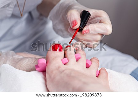 The process of creating a pedicure in the spa salon shot closeup