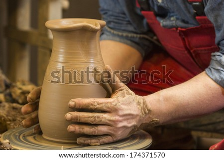 The process of creating pottery by hand - stock photo