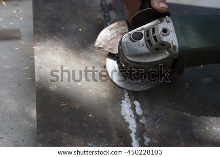 The process of grinding after welding metal. Sparks