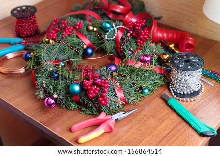 The process of making handicraft christmas wreath - stock photo
