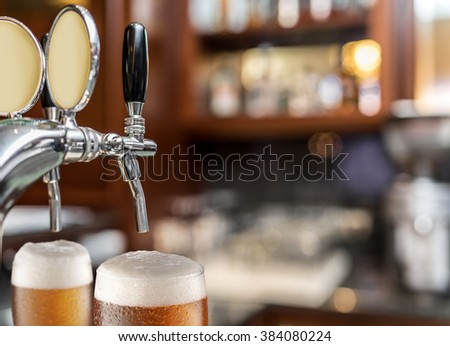 The process of pouring beer into the glass. File contains clipping paths. - stock photo