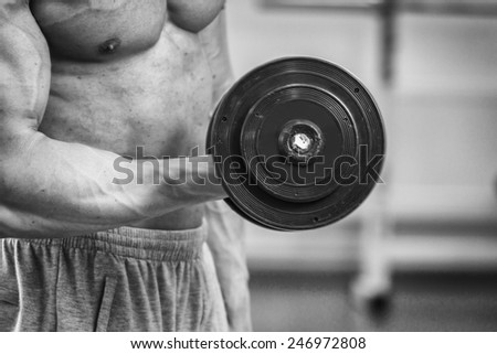 The process of power exercise. Sports. The process of exercises with dumbbells. Healthy lifestyle concept. Fitness, bodybuilding, strength, youth, health.